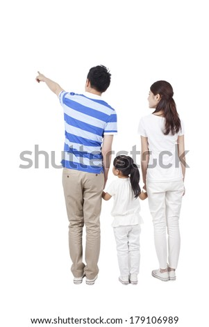 Young family with little girl holding hands together of rear view