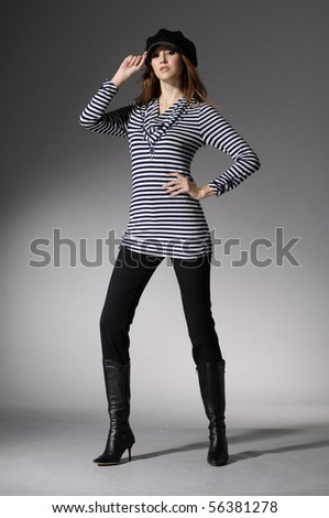 young fashion model on light background posing