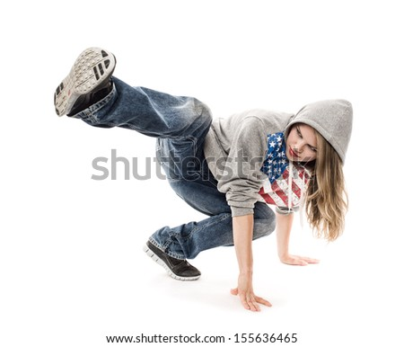 Young girl break dancer moving on the floor, isolated on a white background. Energetic female performing street dance in studio.