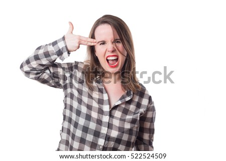 Young girl making a gun gesture and pointing to her head isolated on white background
