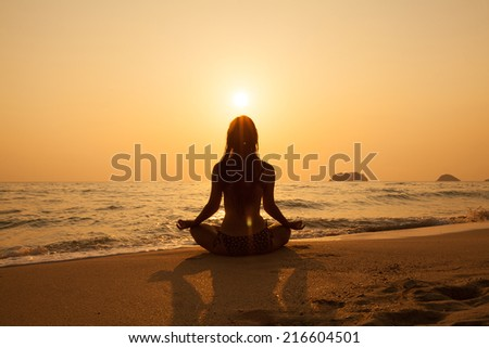 Young girl on a tropical beach at sunset. Summer vacation concept.