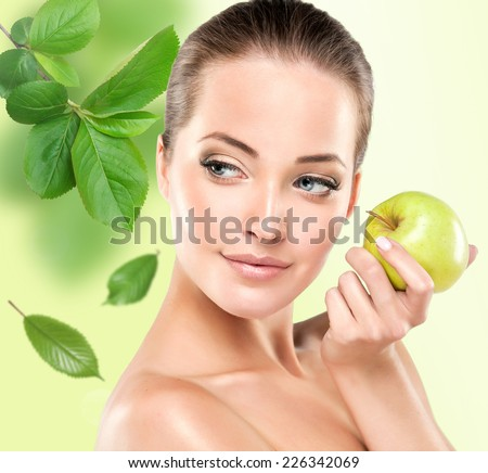 Young girl smiling holding a green Apple. Health & beauty - stock photo