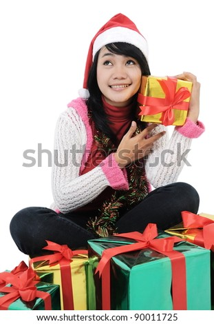 Young girl smiling with Christmas gifts isolated on white background