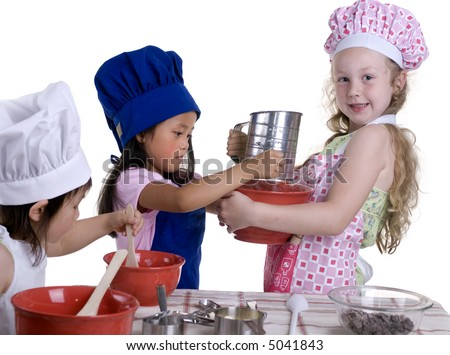 3 young girls having fun in the kitchen making a mess....I mean making something special..... Education, learning, cooking, childhood - stock photo