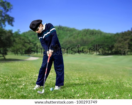 Young golfer swing - stock photo
