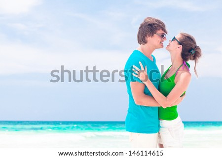young happy couple having fun on the beach. tulum, mexico