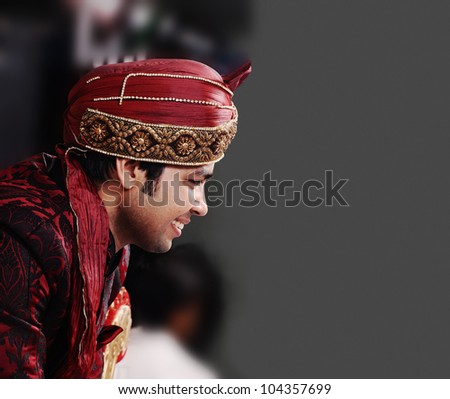 young   indian groom in a traditional clothing - stock photo