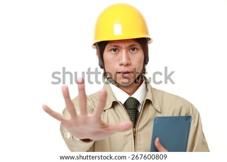 young Japanese man making stop gesture - stock photo