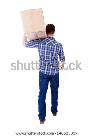 Young man carrying a card box, isolated on white - stock photo