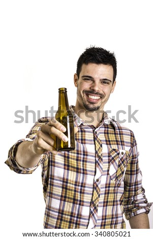 young man drinking beer from a bottle on a white background - stock photo