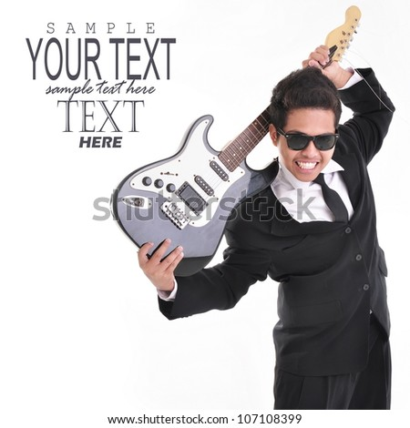 Young man in a suit with guitar and glasses, isolated on white background - stock photo