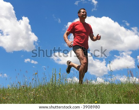 Young man is running along - stock photo