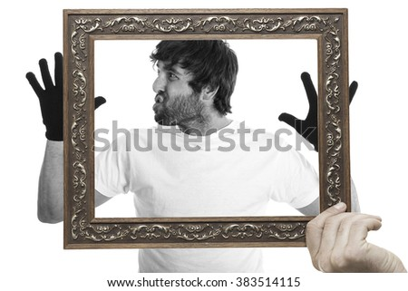 young man showing underneath his shirt inside the frame