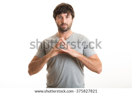 Young man with a gesture of confidence