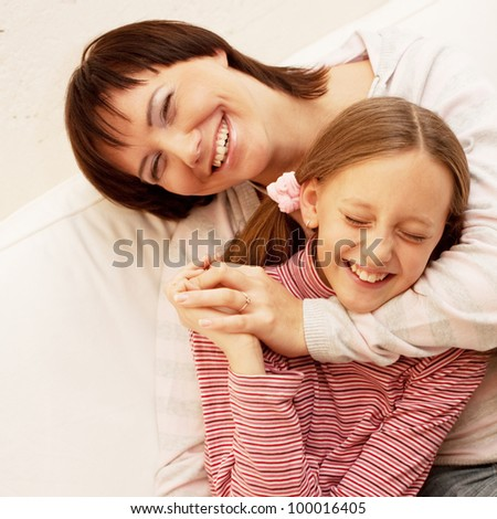 Young Mother and her daughter - stock photo
