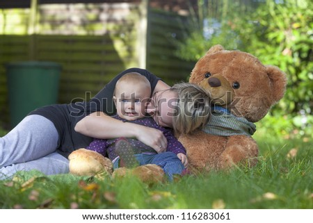 young mother daughter having fun at the garden - stock photo