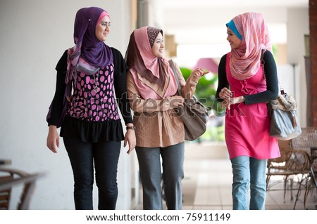 young muslim woman in head scarf walk together