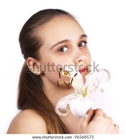 young pretty woman with a flower isolated on a white background - stock photo