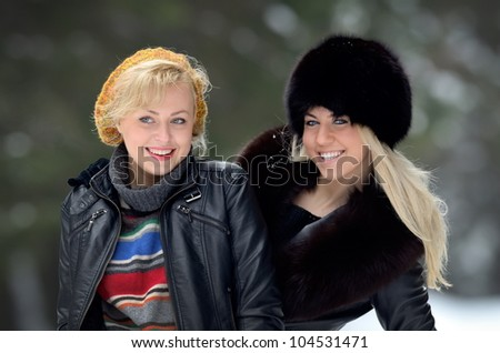 young pretty women outdoor in winter - stock photo