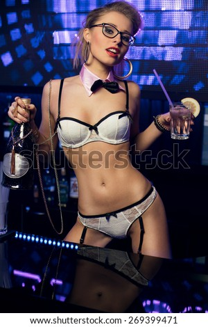Young sexy woman in night club with champagne - stock photo
