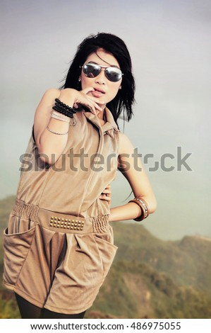 Young slim woman on beach portrait