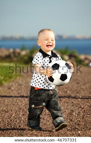 young smile boy play football - stock photo