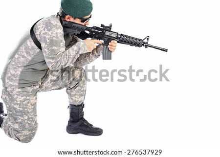 Young soldier or sniper aiming with a rifle isolated on white background