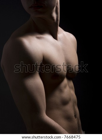 young sporty man over black background