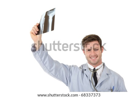 Young successful caucasian man doctor examining x-ray photos. Studio shot. White background - stock photo