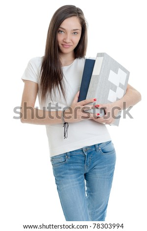 Young woman carrying a pair of thick books - stock photo