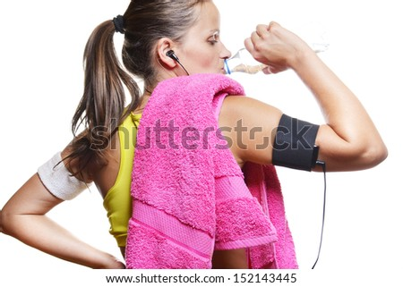 young woman drinking water during her workout , isolated on white background - stock photo