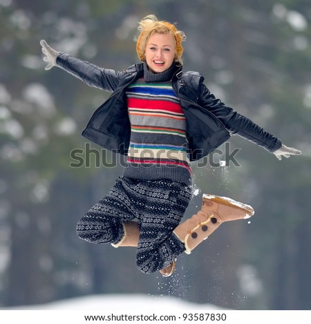young woman enjoying the snow - stock photo