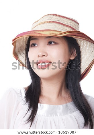 young woman in a big straw hat. - stock photo