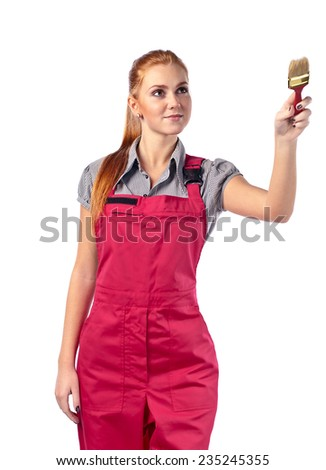 Young woman in red overalls with brush , isolated on white