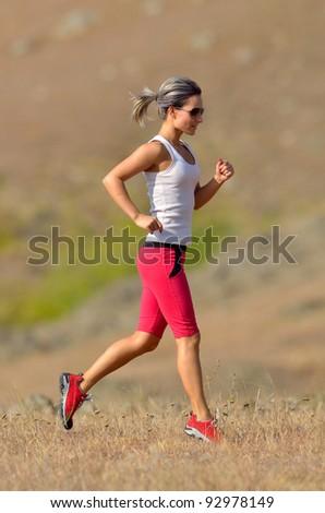 young woman jogging outdoor - stock photo