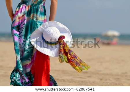 young woman on the beach in summer - stock photo