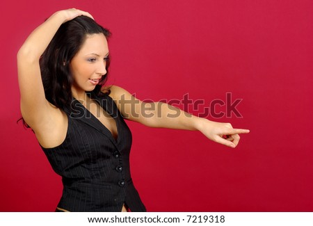 Young woman pointing over red