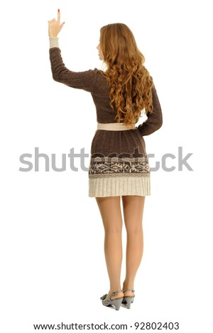 young woman pointing over white background with copy space - stock photo