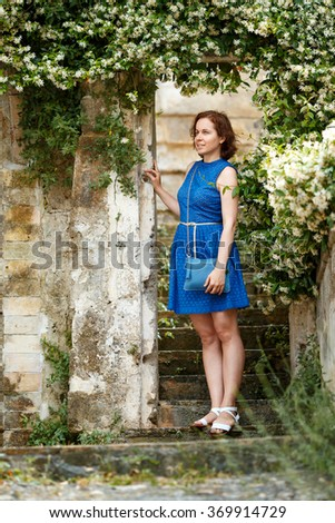 Young woman walking narrow streets at typical italian town, Matera - stock photo
