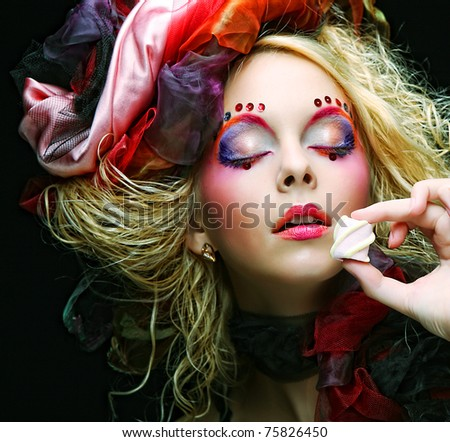 young woman with creative make-up in doll style with cake. - stock photo