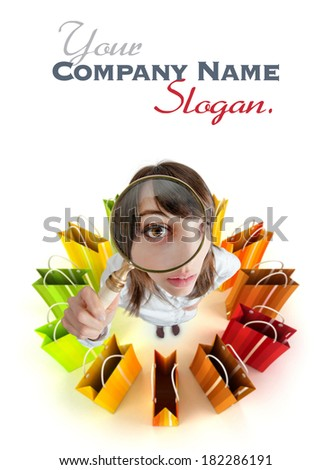 Young woman with magnifying glass surrounded by shopping bags  - stock photo