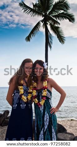 2 young women on a Hawaiian beach - stock photo
