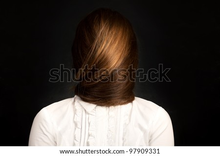 """your face is your hair "" Conceptual photo of young woman with very long hair which covers her face. - stock photo"