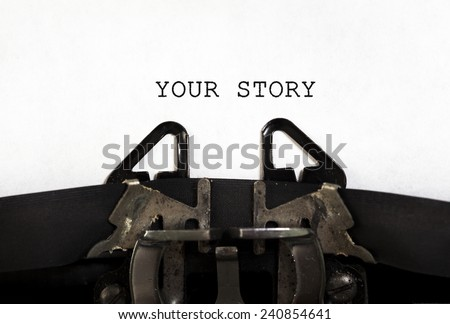 """YOUR STORY"" printed on an old typewriter. - stock photo"
