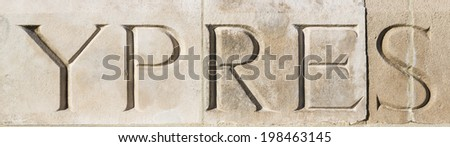 """""""YPRES"""" carved in stone at Tyne Cot War Cemetery, Flanders, Belgium.  Commemorating World War One  - stock photo"""