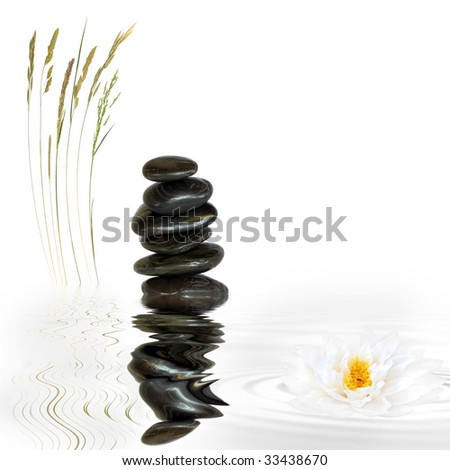 Zen garden abstract of spa treatment stones in perfect balance with wild grass and a lotus lily flower with reflection in grey rippled water, over white background. - stock photo