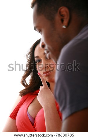 A african american professional cosmetologist touches up a models hair for a Beauty / Fashion / Hair Style / Makeup photo shoot. Isolated on white with room for your text. - stock photo