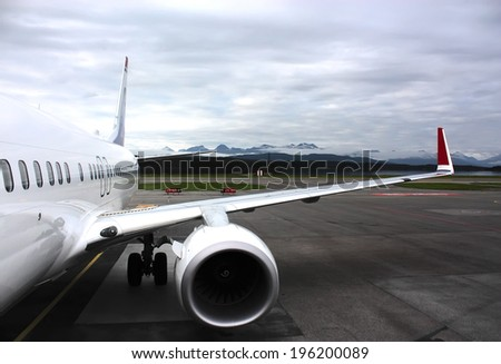 a airplane fragment on a runway, with mountains on a background - stock photo
