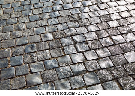A ancient cobblestone Pavement in Rome, Italy, Europe. - stock photo