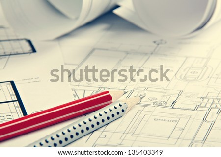 A architect's workspace with plans - stock photo